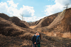 Happy couple smiling outdoors in the mountains Royalty Free Stock Image