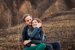 Happy couple smiling outdoors in the mountains Royalty Free Stock Photo