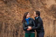 Happy couple smiling outdoors in the mountains Royalty Free Stock Images