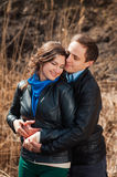 Happy couple smiling outdoors in the mountains Royalty Free Stock Photos