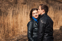 Happy couple smiling outdoors in the mountains Royalty Free Stock Photography