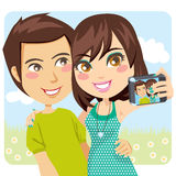 Happy Couple Snapshot. Young happy couple taking a snapshot of themselves with a digital camera Stock Images