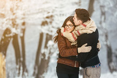 Happy couple in snow park Stock Photo