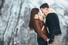 Happy couple in snow park Royalty Free Stock Photo