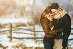 Happy couple in snow park Stock Photo