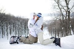 Happy couple of snowboarders Royalty Free Stock Photography