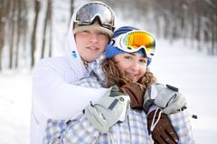 Happy couple of snowboarders Stock Photo