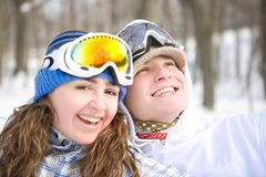 Happy couple of snowboarders Stock Images