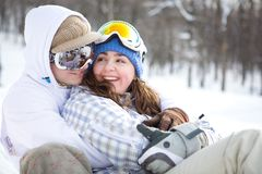 Happy couple of snowboarders Royalty Free Stock Photos