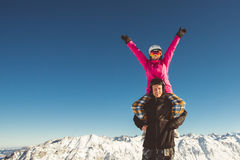 Happy couple of snowboarders in the alpine mountains Royalty Free Stock Photos