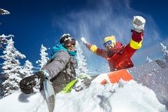 Happy couple of snowboarders having fun Stock Photos