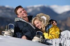 Happy couple snowboarding at ski resort stock image
