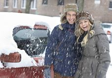 Happy couple in snowfall Stock Image