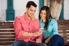 Happy couple social networking Stock Photos