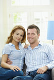 Happy couple on sofa Stock Images
