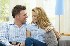 Happy couple on sofa Royalty Free Stock Image