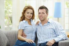 Happy couple on sofa Stock Photos