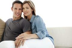Happy couple on sofa Stock Photography
