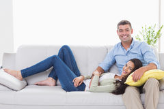 Happy couple on sofa at home Royalty Free Stock Photography