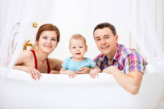 Happy couple with son sitting in bath Stock Photo