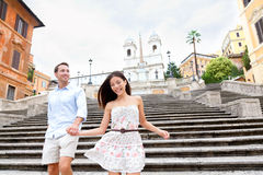 Happy couple on Spanish Steps, Rome, Italy. Happy romantic couple holding hands on Spanish Steps in Rome, Italy. Joyful young interracial couple walking on the Royalty Free Stock Photos