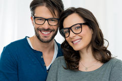 Happy couple with specs. Closeup of smiling couple wearing spectacle Royalty Free Stock Images