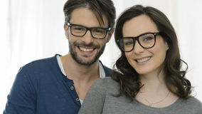 Happy couple with specs stock footage