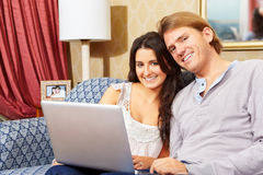 Happy couple spending with laptop royalty free stock image