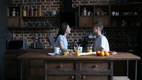 Happy couple spending morning together in kitchen stock footage