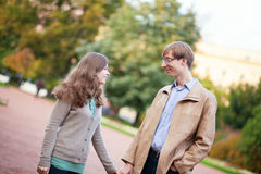 Happy couple spending time together outdoors Royalty Free Stock Images
