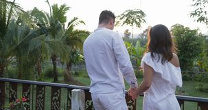 Happy Couple Spinning On Terrace At Sunset, Young Man And Woman Enjoy Beautiful Landscape Embracing stock video footage