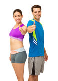 Happy Couple In Sports Wear Gesturing Thumbs Up Royalty Free Stock Image