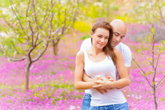 Happy couple in spring park Stock Image