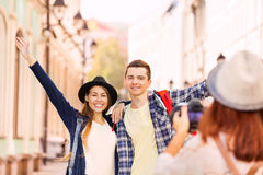 Happy couple stand close and girl shooting them Royalty Free Stock Photo