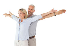Happy couple standing with arms outstretched Stock Images
