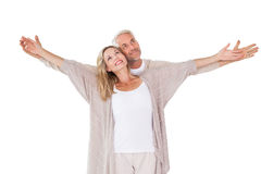 Happy couple standing with arms outstretched Royalty Free Stock Image