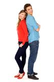 Happy couple standing back to back Stock Image