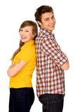 Happy couple standing back to back Royalty Free Stock Photography
