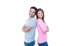 Happy couple standing back to back Stock Photos