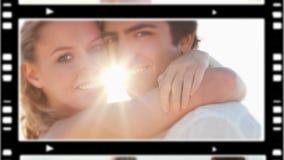Happy couple standing on the beach Stock Photo
