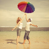 Happy couple standing on the beach Royalty Free Stock Images