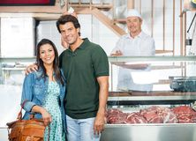 Happy Couple Standing In Butchery Stock Photography