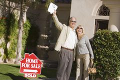 Happy Couple Standing In Front Of House Royalty Free Stock Photo