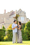 Happy couple standing in front of new home Royalty Free Stock Photography