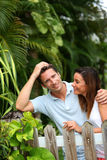 Happy couple standing in front of tropical garden Stock Image