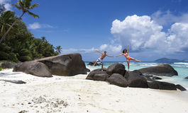 Happy Couple standing on Granite Rocks at Seychelles Stock Photos