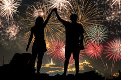 Happy Couple Standing On the hill watching fireworks Stock Photography