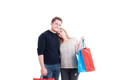 Happy couple standing and  holding lots of shopping bags Royalty Free Stock Photos