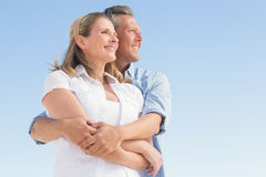 Happy couple standing and hugging Stock Photography