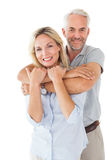 Happy couple standing and hugging Royalty Free Stock Image